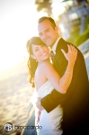 bride and groom on the sand, surf and sand wedding photos