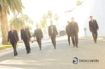 groomsmen walking at san clemente casino
