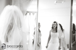 bride in mirror with wedding dress