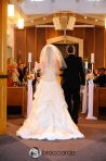 bride and father going down aisle during wedding ceremony